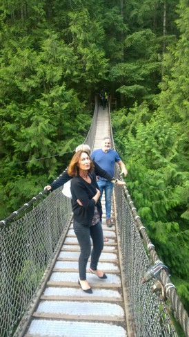 Carol and Peter share a local footbridge outside of Vancouver, Canada.